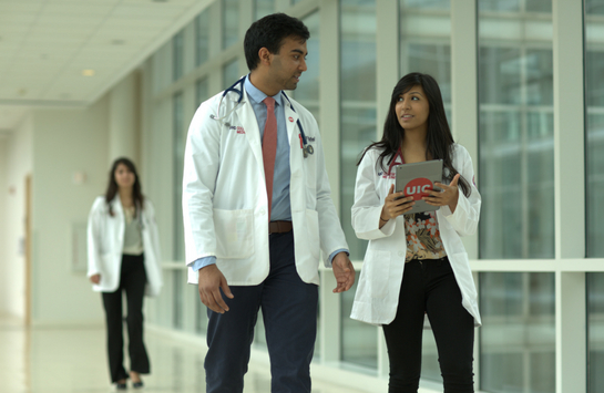 male and female medical students walking down a hallway